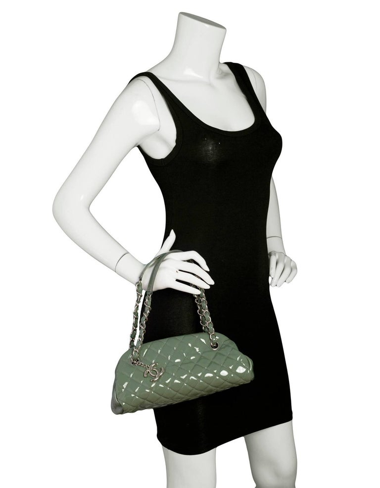 Chanel Green Quilted Patent Just Mademoiselle Small Bowling Bag  Made In: Italy Year of Production: 2010-2011 Color: Green Hardware: Silvertone Materials: Patent leather, metal Lining: Green textile Closure/opening: Open top, center compartment ahs