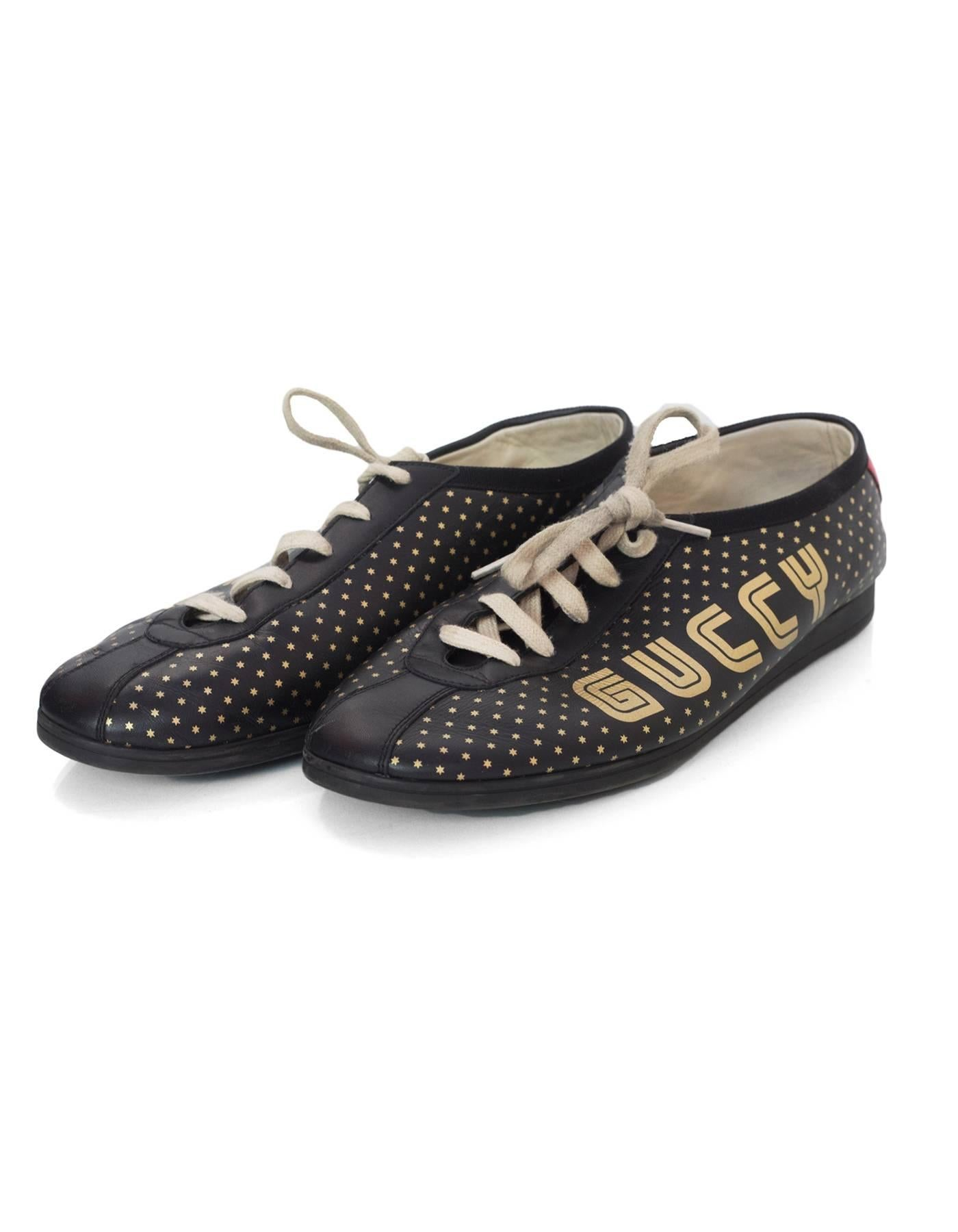 8650487ee Gucci Men's Black and Gold Falacer Guccy Sega Logo Sneakers Sz 9.5 For Sale  at 1stdibs