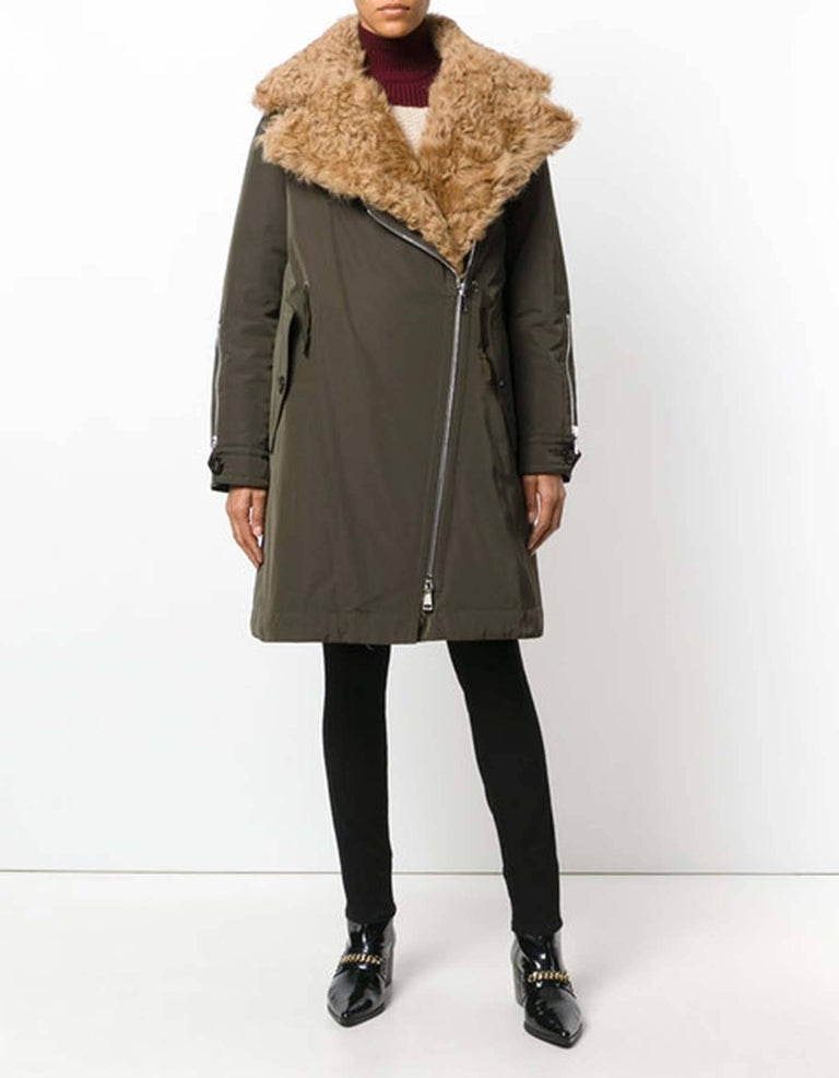 Moncler Olive Green Aucuba Shearling & Twill Oversized Down Coat Sz MONCLER 4  *MISSING INSERT*  Made In: Italy Year Of Production: 2018 Color: Olive Green Composition: 70% polyester, 30% cotton Lining: 100% nylon Closure/Opening: Front zip
