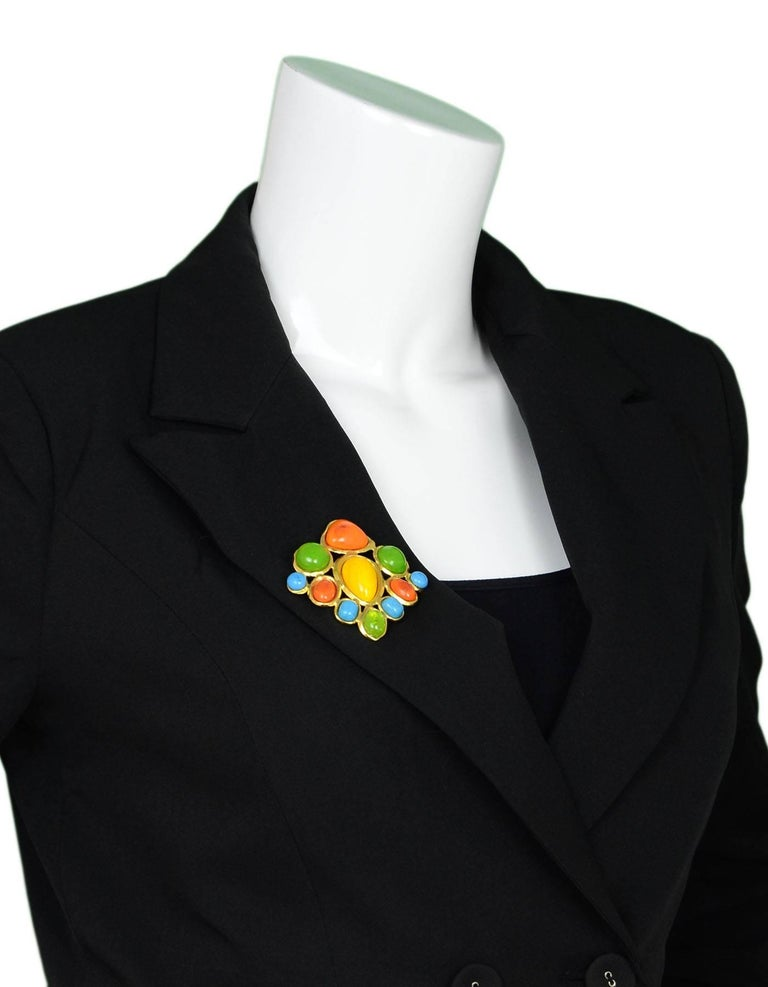 Chanel  Multi-Color Brooch  Made In: France Year Of Production: 1993 Color: Yellow, green, orange, blue, gold Materials: Metal, stones Closure: Pin back closure Stamp: Chanel 93 CC P Made in France Overall Condition: Excellent pre-owned condition,