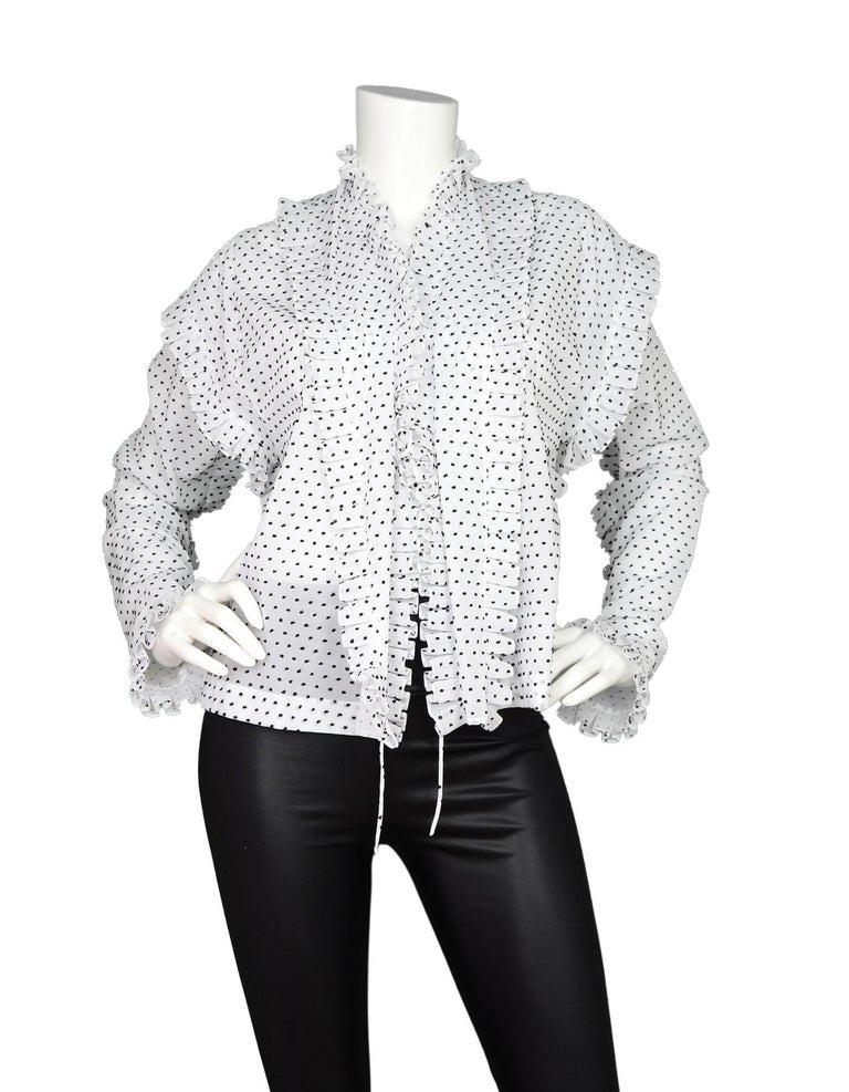 Alaia White/Black Textured Polka Dot Ruffle Blouse Sz 44  Made In: Italy Color: White with black polka dots Materials: 100% cotton Opening/Closure: Two ties in front Overall Condition: Excellent pre-owned condition with tags attached  Estimated