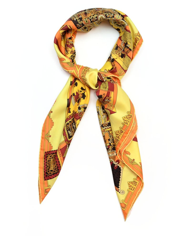 Hermes Yellow Astres Et Soleils Silk Scarf  Made In: France Color: Yellow, brown, patterned  Materials: 100% silk Overall Condition: Excellent pre-owned condition   Measurements:  36