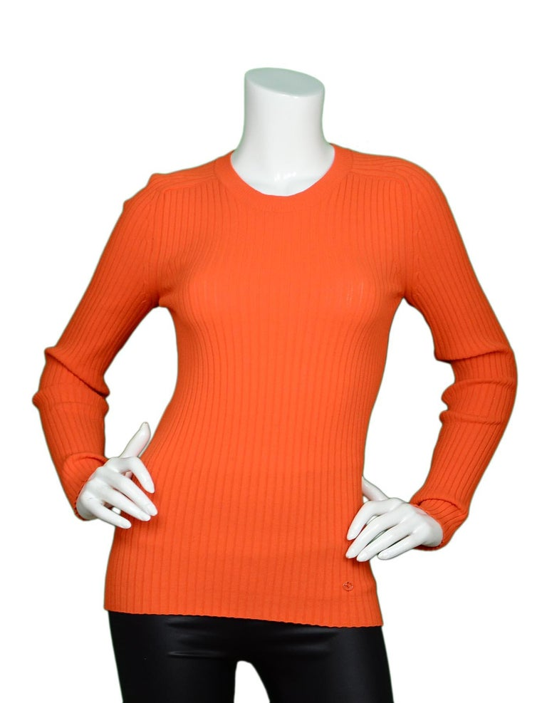 Gucci Neon Orange Long Sleeve Ribbed Crew Neck Sweater Sz M  Color: Neon orange Materials: No composition tag, rib knit material  Opening/Closure: Pull over Overall Condition: Very good pre-owned condition with exception of no tags, loose stitching