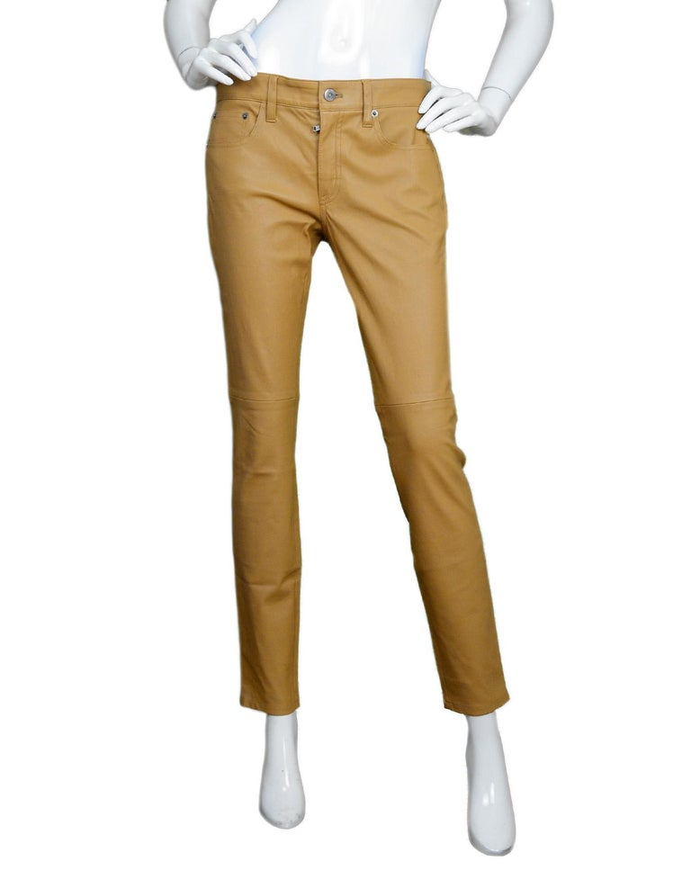 Ralph Lauren Purple Label NWT Nude/Tan Leather Skinny Slacks Pants Sz 6  Made In: U.S.A Color: Nude/tan Materials: 100% lambskin Lining: 95% cotton, 5% elastane  Overall Condition: Excellent like new condition with original tags attached  Estimated