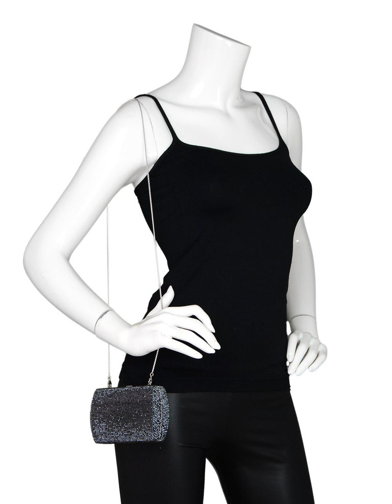 Judith Leiber Black Metallic Swarovski Crystal Small Minaudiere Evening Bag W/ Strap  Made In: Handmade in Thailand Color: Black Hardware: Silvertone Materials: Swarovski crystal, metal Lining: Silver leather Closure/Opening: Push top