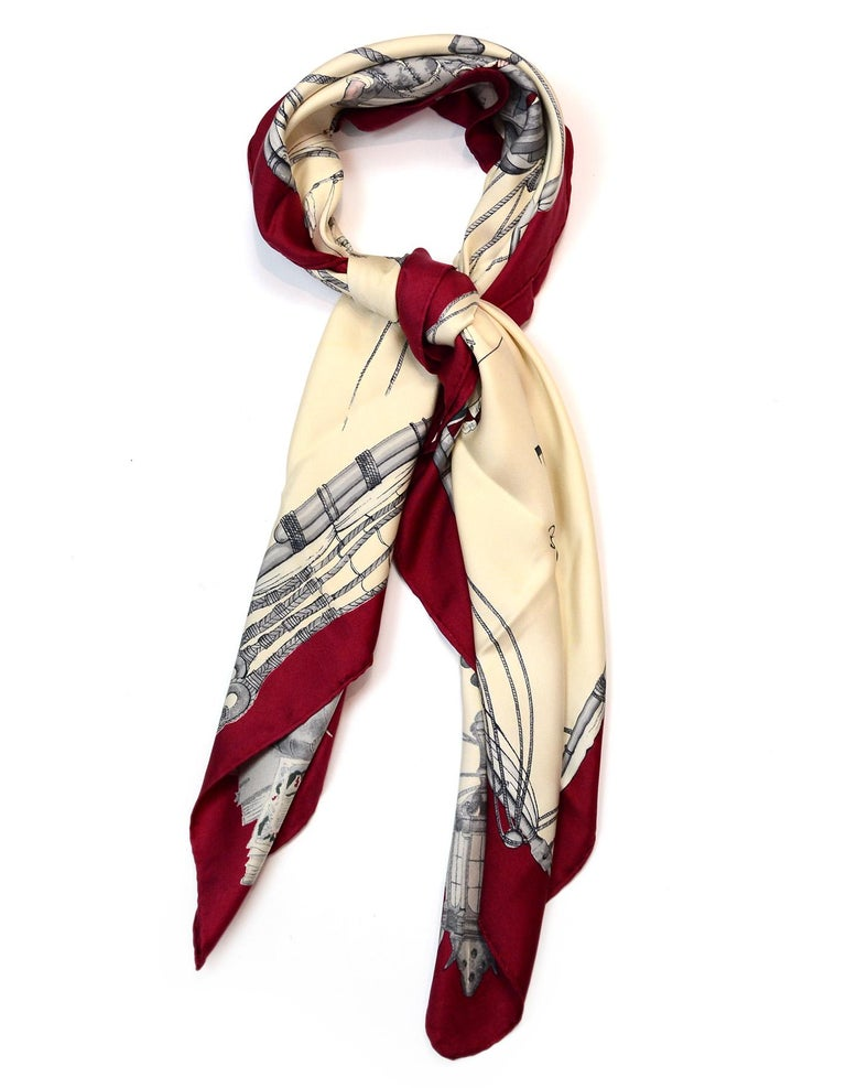 Hermes Cream/Burgundy Caravelle 90 CM Silk Scarf   Color: Cream and burgundy  Materials: 100% silk Overall Condition: Excellent pre-owned condition with the exception of a watermark and some staining at a fold Estimated Retail: $395 +