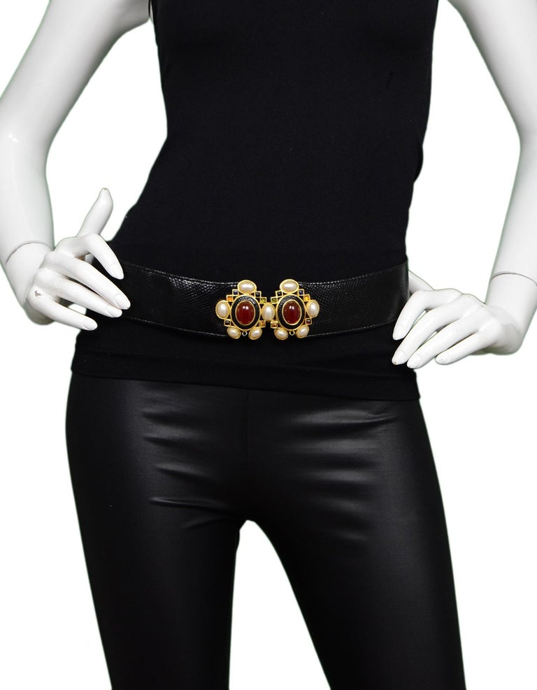 Judith Leiber Black Lizard Belt W/ Pearl & Multi-Color Stone Closure Sz M  Color: Black with white, red, green, blue stones Hardware: Goldtone Materials: Lizard, pearl and stones Closure/Opening: Hook eye closure  Overall Condition: Very good