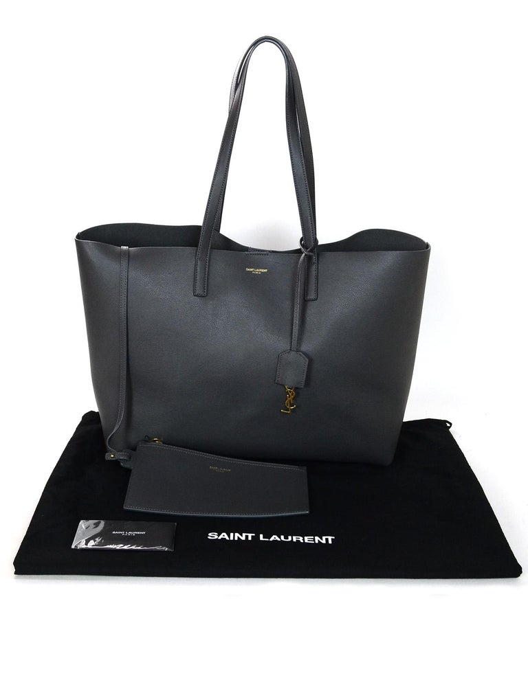 834dd9bcf5 Yves Saint Laurent Storm Grey Leather Tote Bag w/ YSL Clochette & Insert  For Sale