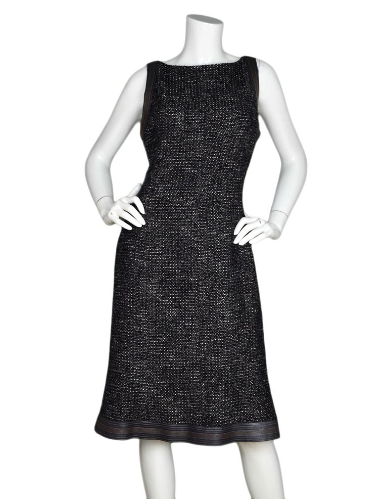 Chanel Black/White/Brown Tweed Dress W/ Leather Trim Sz 46  Made In: France Color: Black, white, brown  Materials: 77% wool, 13% cotton, 6% nylon, 2% polyester Lining: 100% silk Opening/Closure: Hidden back zipper with two hook eyes at top Overall