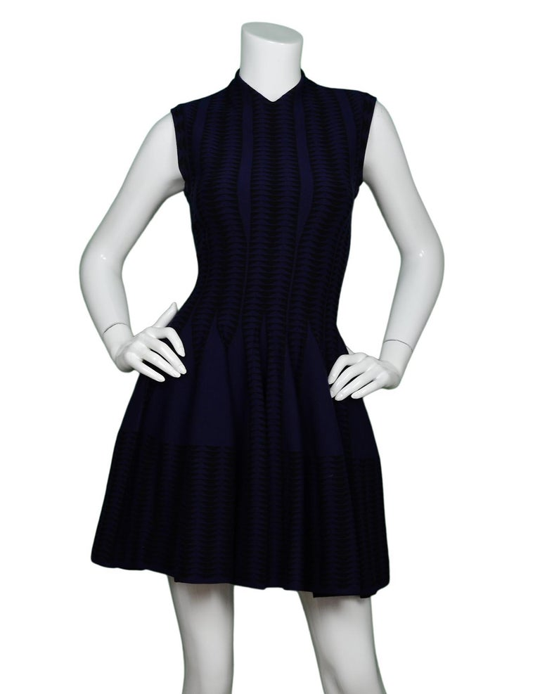 Alaia Navy/Black V-Neck Fit & Flare Cap Sleeve Dress Sz 38  Made In: Italy Color: Navy/black Materials: 42% wool, 36% viscose, 12% polyester, 8% nylon, 2% elastane  Opening/Closure: Hidden back zipper Overall Condition: Excellent pre-owned condition