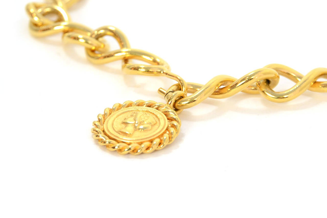 Orange Chanel Vintage Goldtone Coco Coin Swirl Chain Link Belt/Necklace For Sale