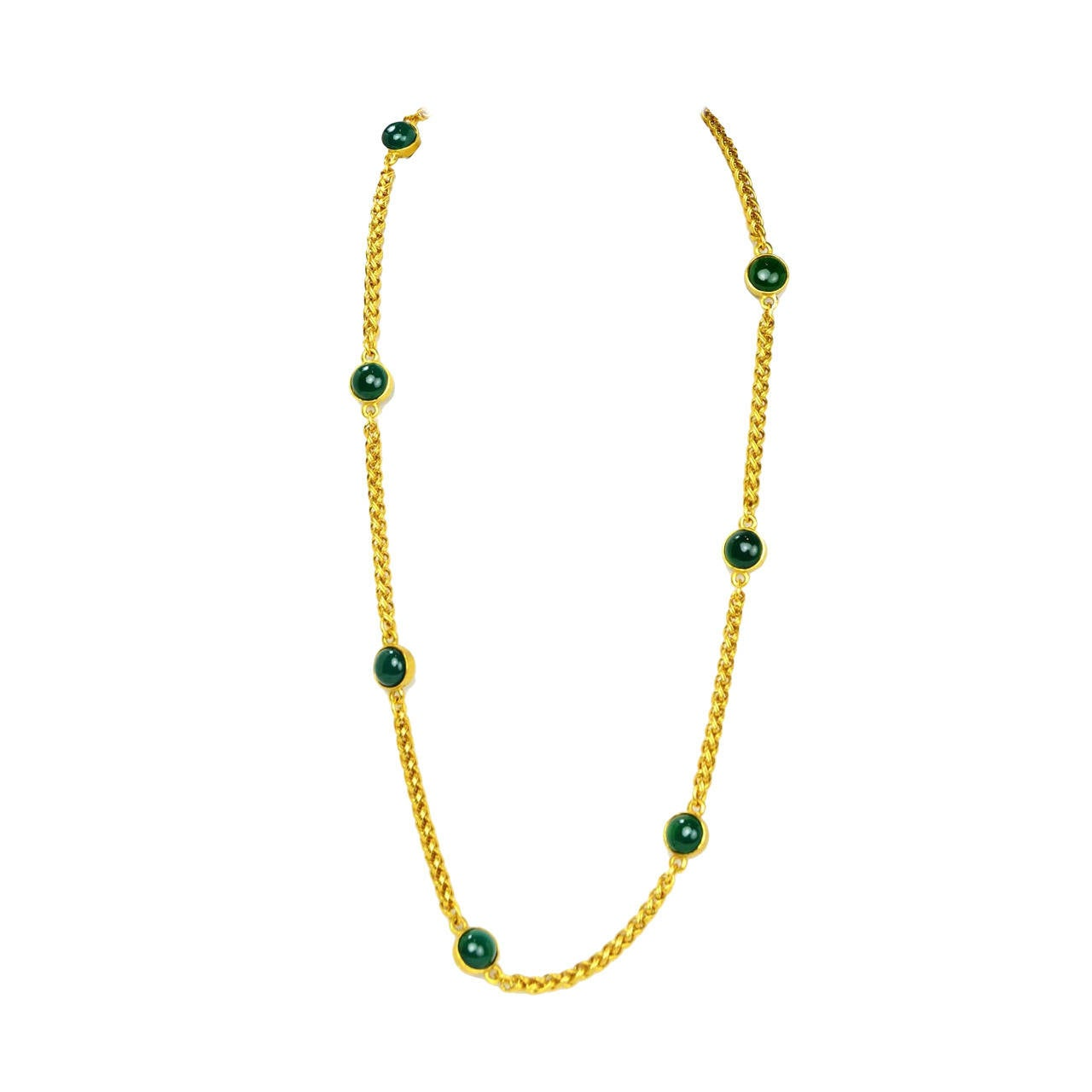 Chanel Vintage '95 Gold Link & Green Gripoix Necklace Gold chain features intricate braid detailing  Made in: France Year of Production: 1995 Stamp: 95 CC A Closure: Hook and eye closure Color: Goldtone and green Materials: Metal and glass Overall
