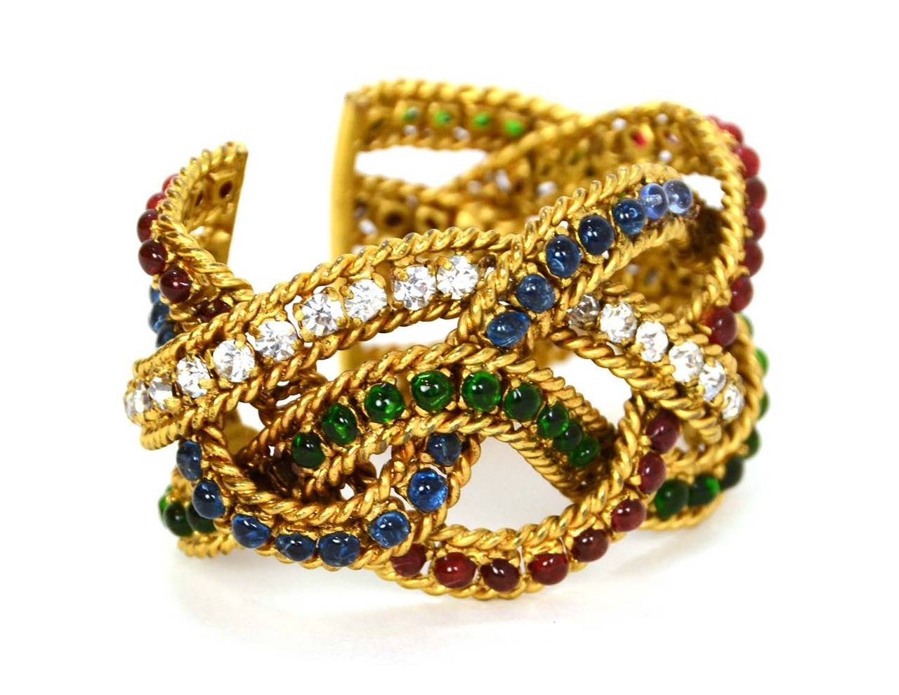 Chanel Vintage Gripoix & Woven Gold Cuff Features red, green and blue gripoix and crystals throughout  Made in: France Stamp: Chanel Closure: None Color: Gold, red, green and blue Materials: Metal, glass and crystals Overall Condition: Very god