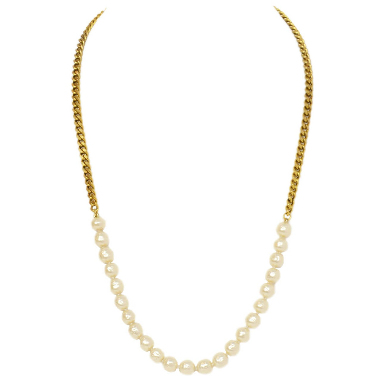 Chanel Vintage '84 Gold Chain & Pearl Necklace  Made in: France Year of Production: 1984 Stamp: CHANEL CC 1984 Closure: Hook Color: Goldtone and ivory Materials: Metal and faux pearls Overall Condition: Excellent with the exception of some