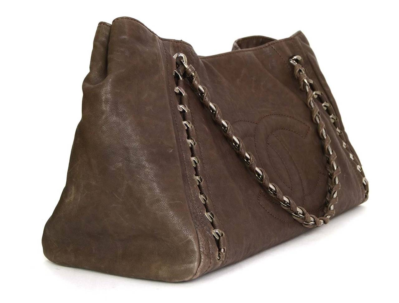 Chanel Brown Distressed Leather Tote Features Silvertone Chain Throughout Exterior As Well Large Embossed Cc