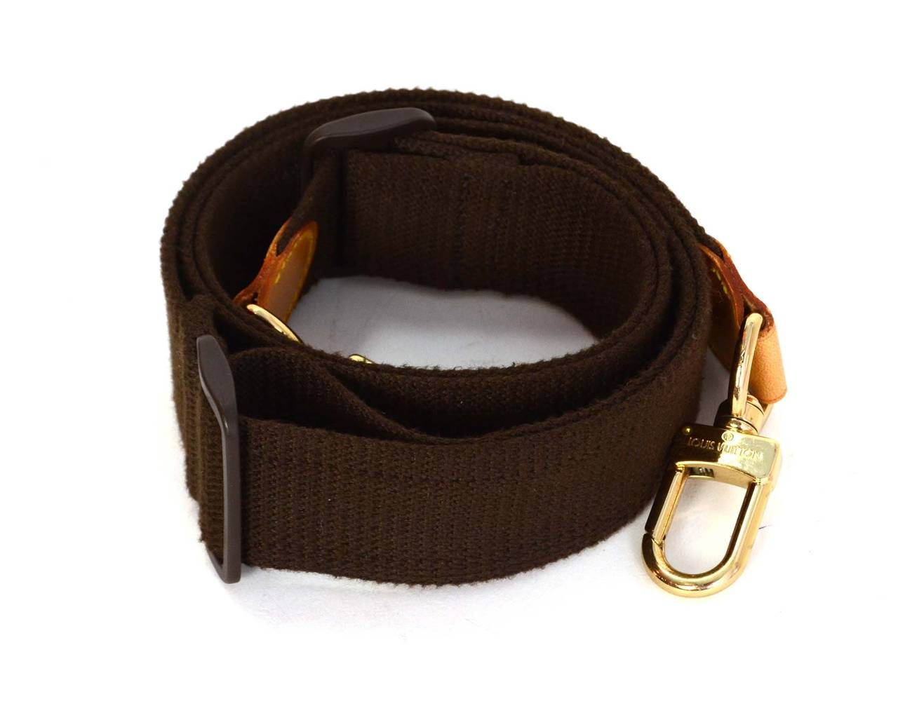 2465e1e61aff Louis Vuitton Brown Canvas Keepall Bag Strap Features sliding buckle to  extend or retract to varying