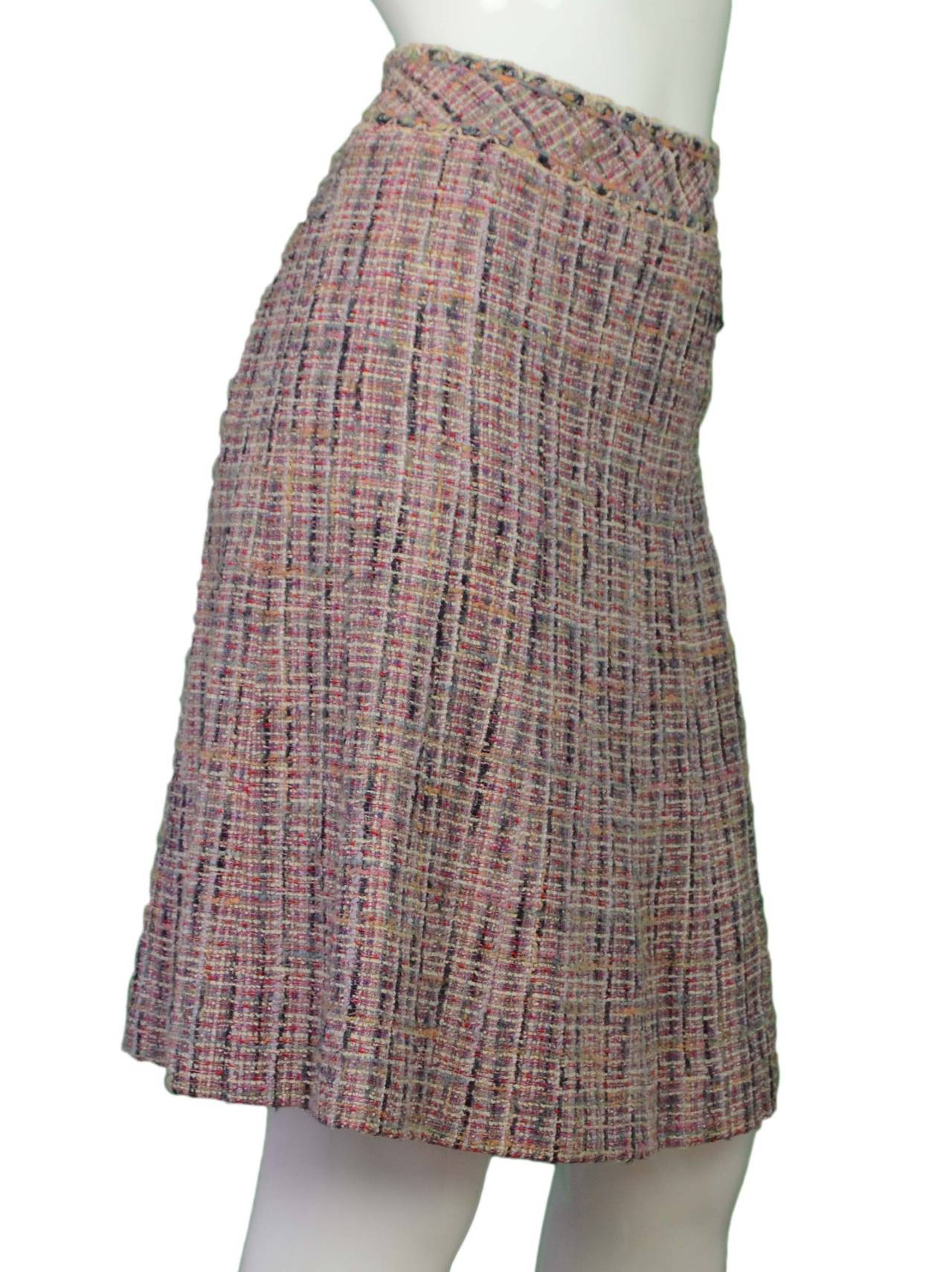 Chanel Multi-Colored Tweed A-Line Skirt  Features small silvertone cc pendant on front left hip of skirt Made in: France Year of Production: 2003 Color: Multi-colored Composition: 58% cotton, 18% wool, 15% silk, 6% rayon, and 3% nylon Lining:
