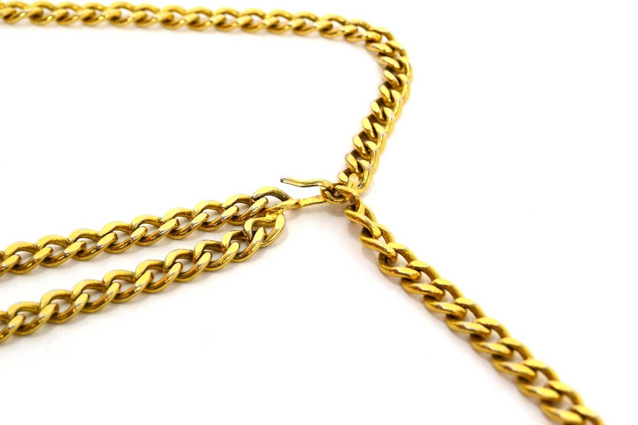 Chanel Vintage '50s-'60s Gold Three Tier Chain Link Belt Features lion pendant at end Made In: Not bold Year of Production: 1950s-1960s Color: Goldtone Materials: Metal Closure/Opening: Hook Stamp: CHANEL Overall Condition: Very good with