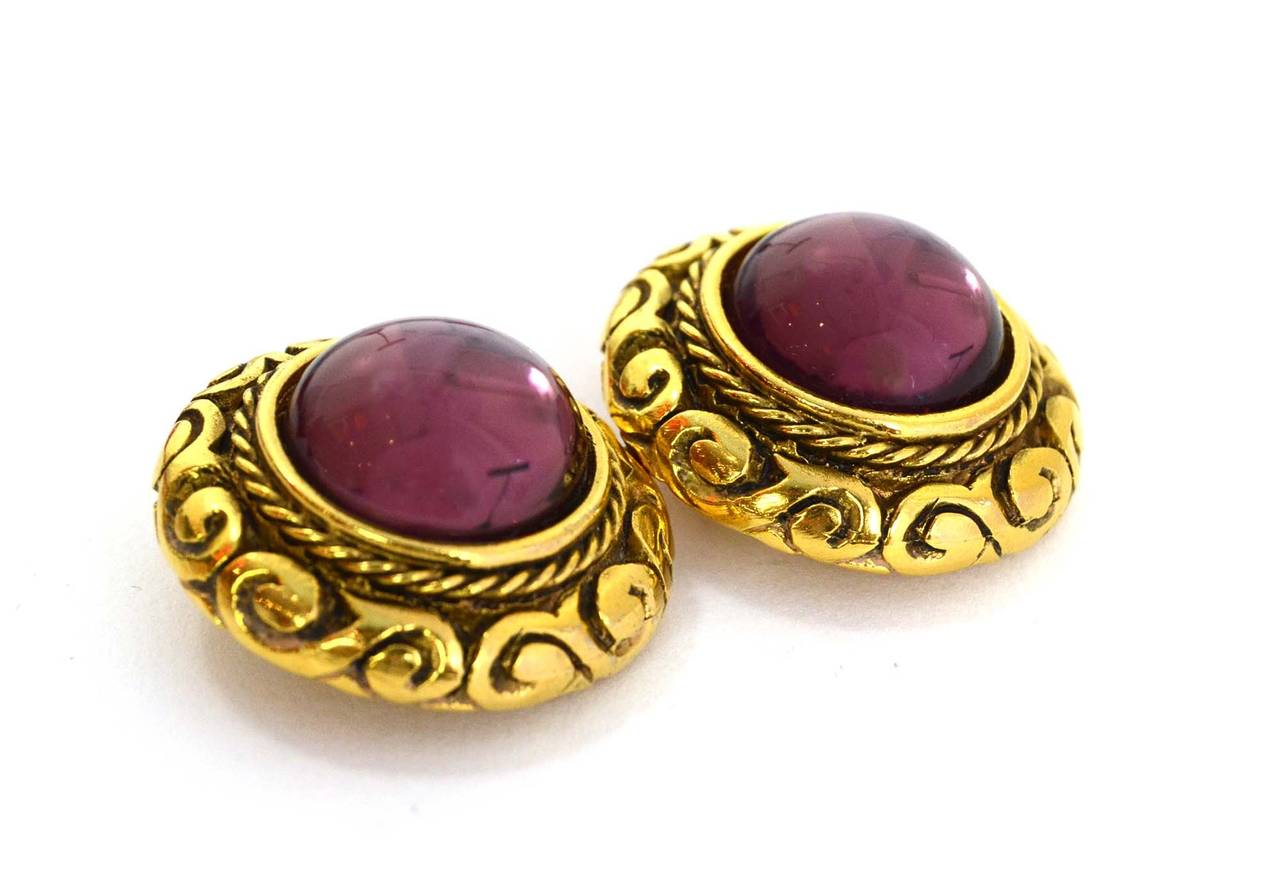 Chanel Vintage '90s Gold & Purple Gripoix Clip On Earrings Made in: France Year of Production: 1990-1992 Stamp: Chanel CC Made in France Closure: Clip on Color: Goldtone and purple Materials: Metal and poured glass Overall Condition: