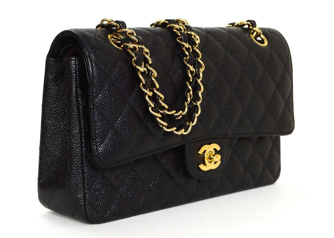2eb4b3265372 Chanel Black Quilted Caviar Medium Classic Double Flap Bag Features  adjustable shoulder strap Made in: