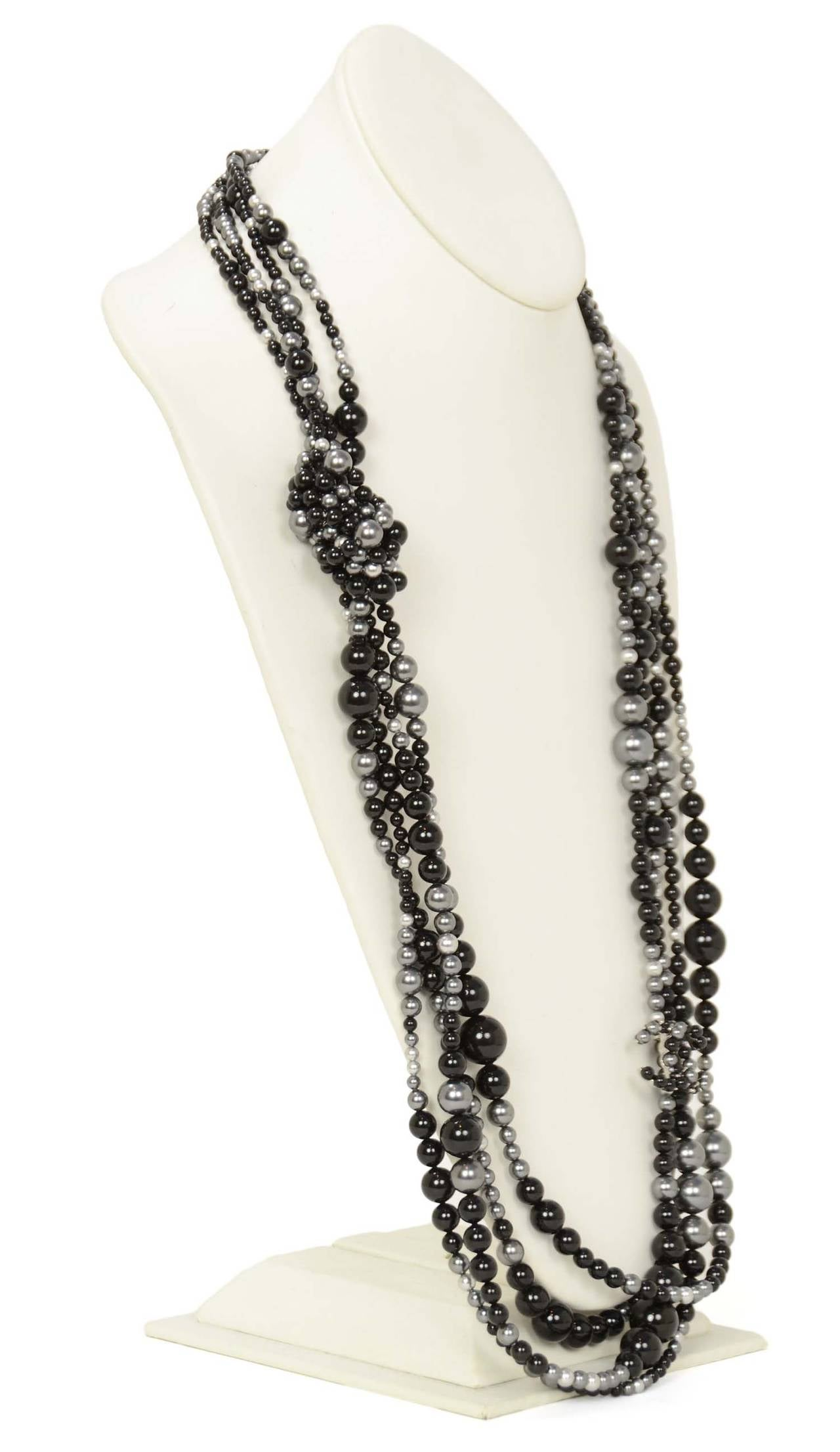 Features different sized faux pearls and beads with a grey and black DD and knotted detail. Can be worn doubled as a multi-strand choker.