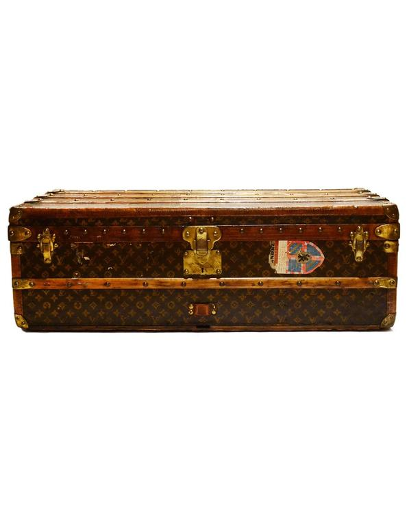 Louis Vuitton Vintage Monogram Rolling Cabin Trunk w/Insert c 1920's Features vintage travel stickers throughout exterior as well as A.S.L. painted on side of trunk in yellow Color: Brown, tan, and brass Hardware: Brass Materials: Coated canvas,