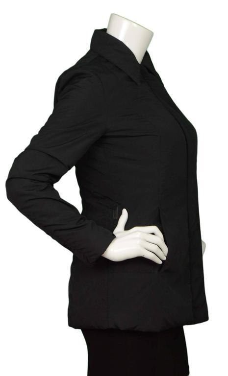 Gucci Black Rain Jacket & Removable Fur Vest  Fur vest snaps into lining of jacket  Made In: Italy Color: Black Composition: Jacket- 53% nylon, 42% polyester, 5% polyurethane, Vest- 100% fur Lining: Black, 53% nylon, 42% polyester, 5%