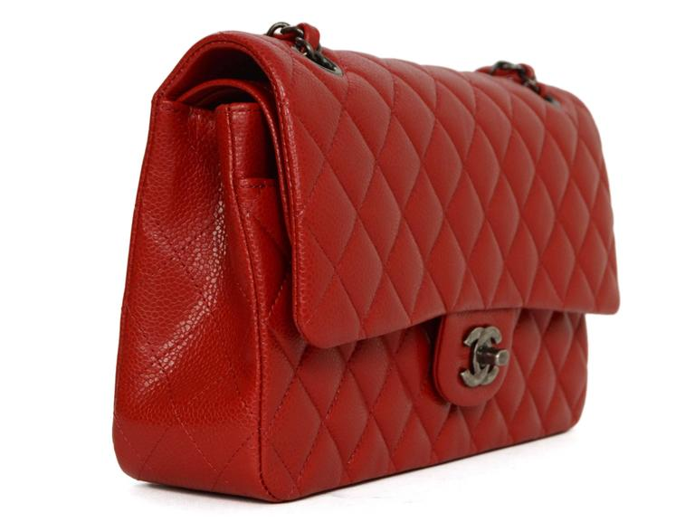 d3b5a1035c6d Chanel '15 Red Caviar Medium Classic Double Flap Bag Features adjustable  shoulder straps Made In