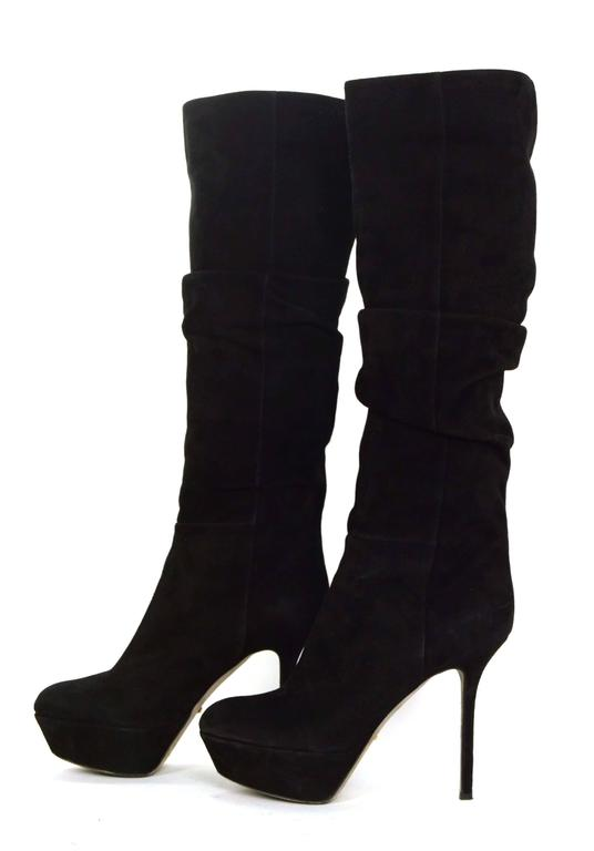 Sergio Rossi Black Suede Platform Boots  Features ruching towards top of shaft Made In: Italy Color: Black Materials: Suede Closure: Pull on Sole Stamp: Sergio Rossi Vero Cuoio Made in Italy 36 1/2 Retail Price: $1,250 + tax Overall