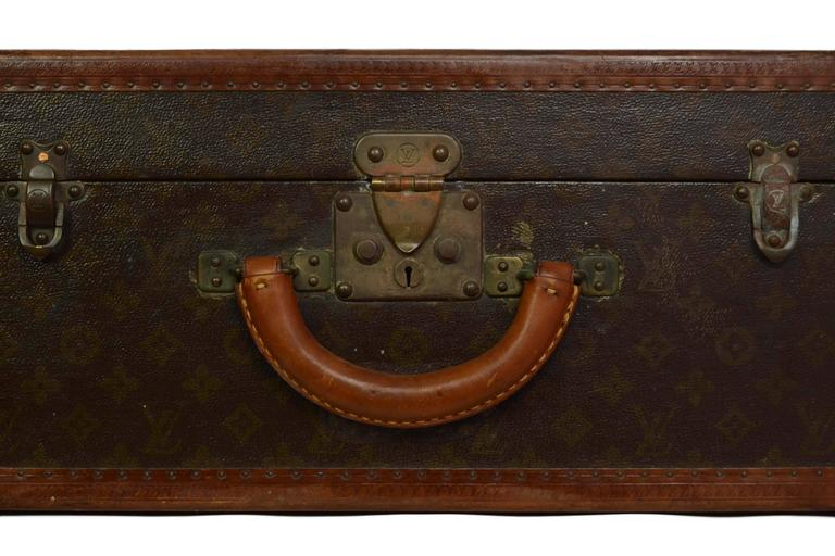 Louis Vuitton Vintage Monogram Square Trunk  Made In: France Color: Brown and bronze Hardware: Brass Materials: Coated canvas and leather Lining: Beige linen Closure/Opening: S lock closure with double sided trunk latches Exterior Pockets: