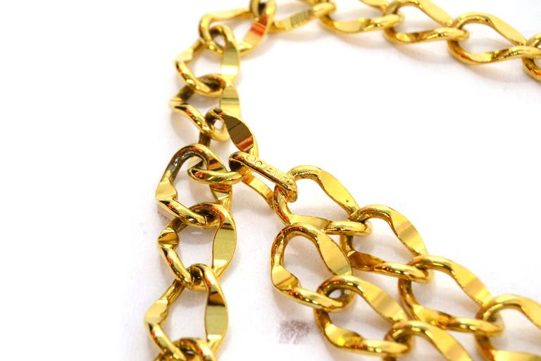 Chanel Gold Chain Link Medallion Belt  Features a short second tier and a CC coin Color: Goldtone Materials: Metal Closure: Hook closure Stamp: Chanel Overall Condition: Excellent pre-owned condition Includes: Chanel box Measurements: