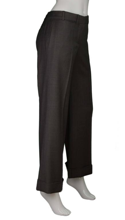 Chloe Grey Wool Wide Leg Pants  Features wide cuffs at hemlines Made In: France Color: Grey Composition: 100% wool Lining: 100% cotton Closure/Opening: Front zipper and hook and eye closure Pockets: Two hip pockets, two small slit pockets,