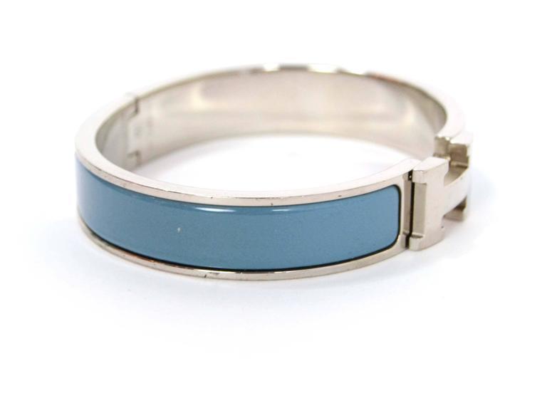 Hermes Blue Jean Palladium Enamel Narrow Clic Clac      Made In: France      Color: Blue Jean      Hardware: Palladium      Materials: Enamel, metal      Closure/Opening: H twist lock      Serial Number/Date Code: HERMES MADE IN