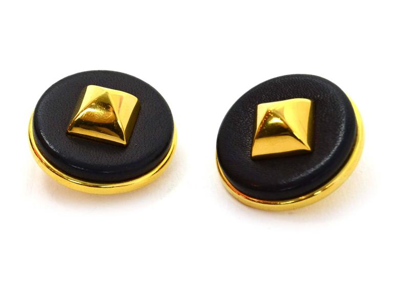 """Hermes Black Leather & Gold Medor Clip On Earrings  Color: Gold and black Materials: Metal and leather Closure: Clip on Stamp: Hermes Paris Overall Condition: Excellent pre-owned condition Measurements:  Diameter: 1.5"""""""