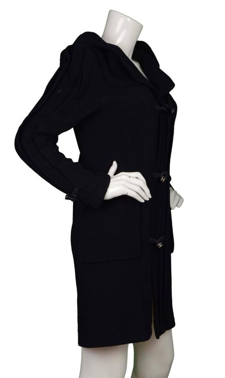 Chanel Navy Pleated Toggle Front Coat  Features hood Made In: France Year of Production: 2006 Color: Navy Composition: 100% wool Lining: Navy, 100% silk Closure/Opening: Toggle button down Exterior Pockets: Two patch pockets Interior