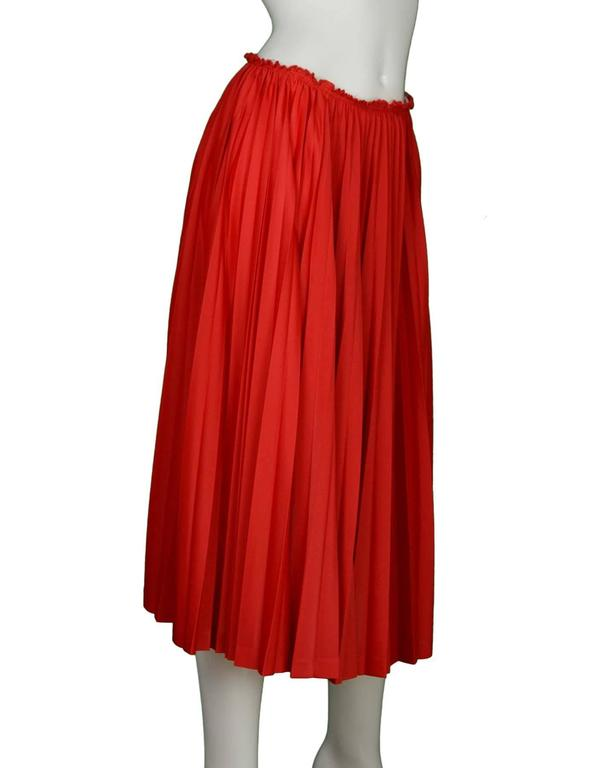 41221ec26151 Comme Des Garcon Girl Red Pleated Midi Skirt Features gathered pleating  throughout Made in: Japan