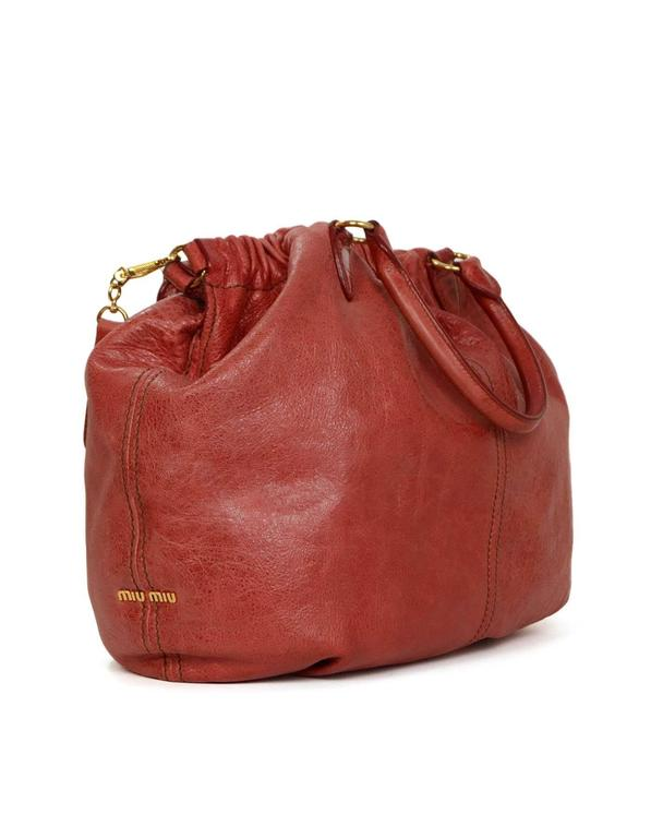 Miu Miu Red Distressed Leather Hobo Bag Features optional crossbody strap  Made In  Italy Color 683dfb62f1713