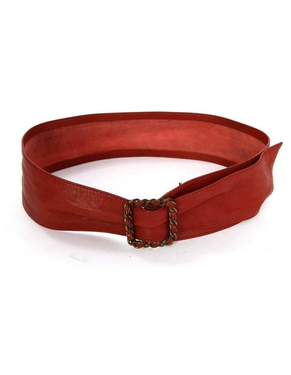Chanel Red Leather Sash Belt  Features red leather woven brass chain link belt buckle Color: Red Hardware: Brass Materials: Leather and metal Closure/Opening: Adjustable belt buckle Stamp: Chanel Overall Condition: Very good vintage,