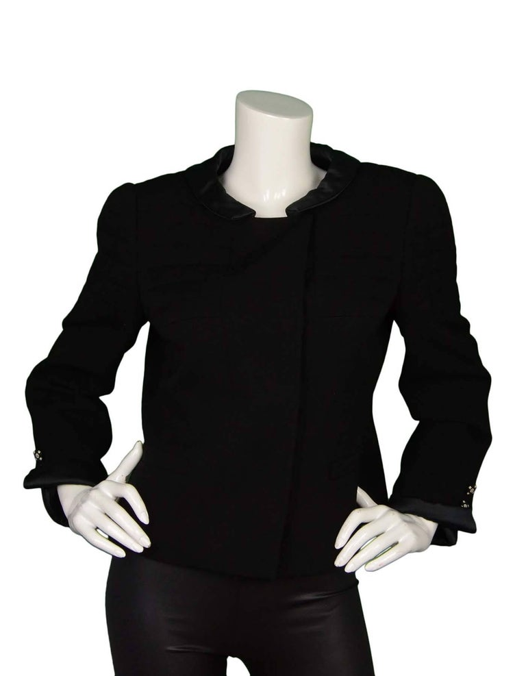 Chanel Black Wool Jacket Sz 44 Features light shoulder padding with quilted detail, and sateen trim at collar and sleeves with rhinestone buttons  Made In: France Year of Production: 2006 Autumn Color: Black Composition: 100% Wool Lining: