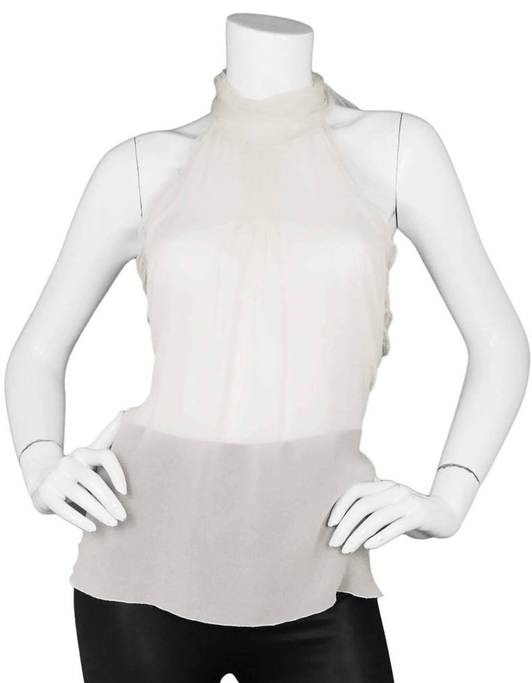 Chanel Sheer Ivory Silk Halter Top  Features pleating at front  Made In: Italy Year Of Production: 2005 Autumn Color: Ivory Composition: 100% Silk Lining: None Closure/Opening: Tie closure at neck and back Overall Condition: Excellent pre-owned
