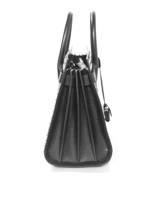 100% Authentic Saint Laurent Black Studded Small Sac De Jour Tote.  Festures black grain de pourde leather with silvertone stud detailing throughout bag.