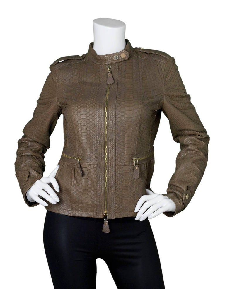 Burberry London Fawn Python Peplum Jacket   Made In: Italy Color: Fawn Composition: 100% python skin Closure/Opening: Front double zip closure Exterior Pockets: Two hip zip pockets Interior Pockets: None Retail Price: $5,750 + tax Overall Condition: