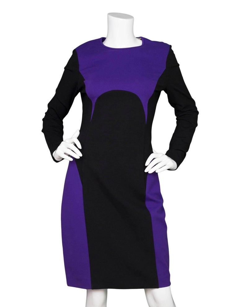 Michael Kors Purple & Black Sheath Dress  Made In: Italy Color: Black and purple Composition: 73% rayon, 22% polyamide, 5% spandex Lining: Purple and black, 61% acetate, 39% rayon Closure/Opening: Back zip up Exterior Pockets: None Interior