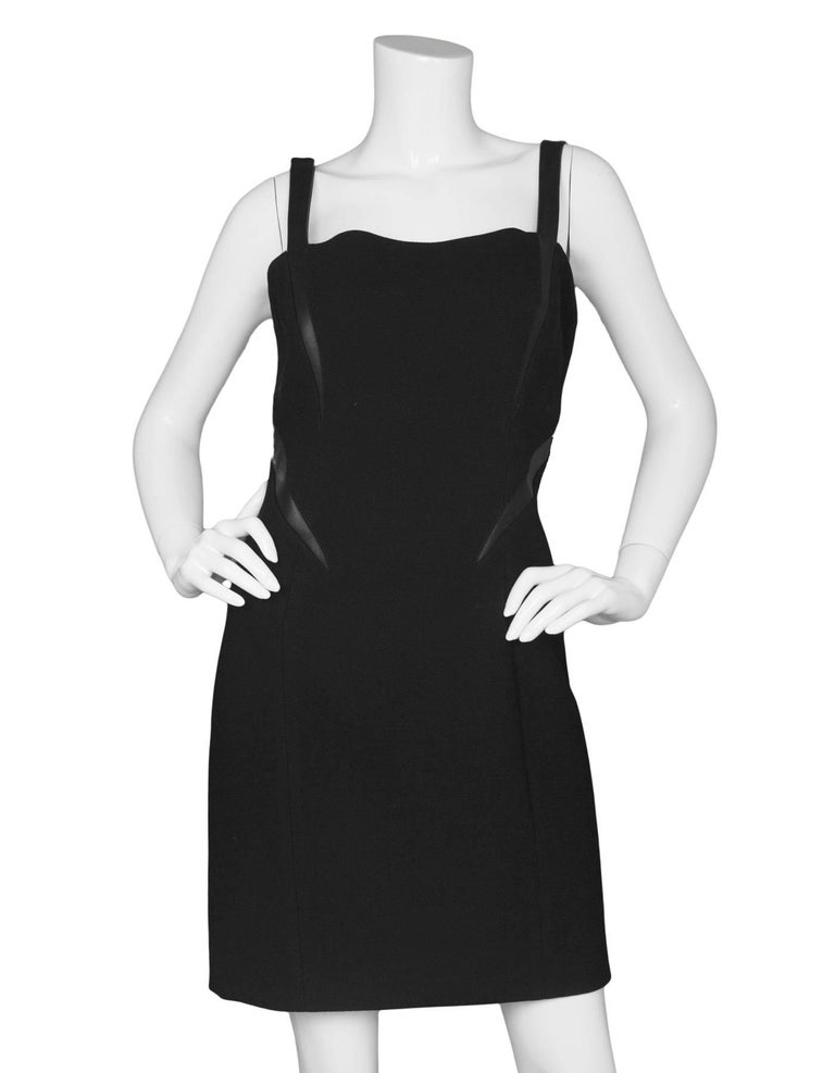 Michael Kors Black Shift Dress Features leather trim and shoulder straps  Made In: Italy Color: Black  Composition: Not given- believed to be a wool-blend, trim- 100% leather Lining: Black, nylon-blend Closure/Opening: Back center zip up Exterior