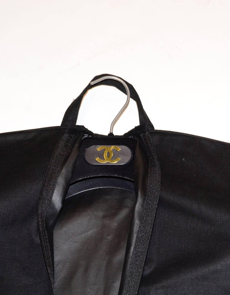 a627cd2a507c Chanel Black Canvas Garment Bag & Velvet Coat Hanger Set Garment bag  features snaps for folding