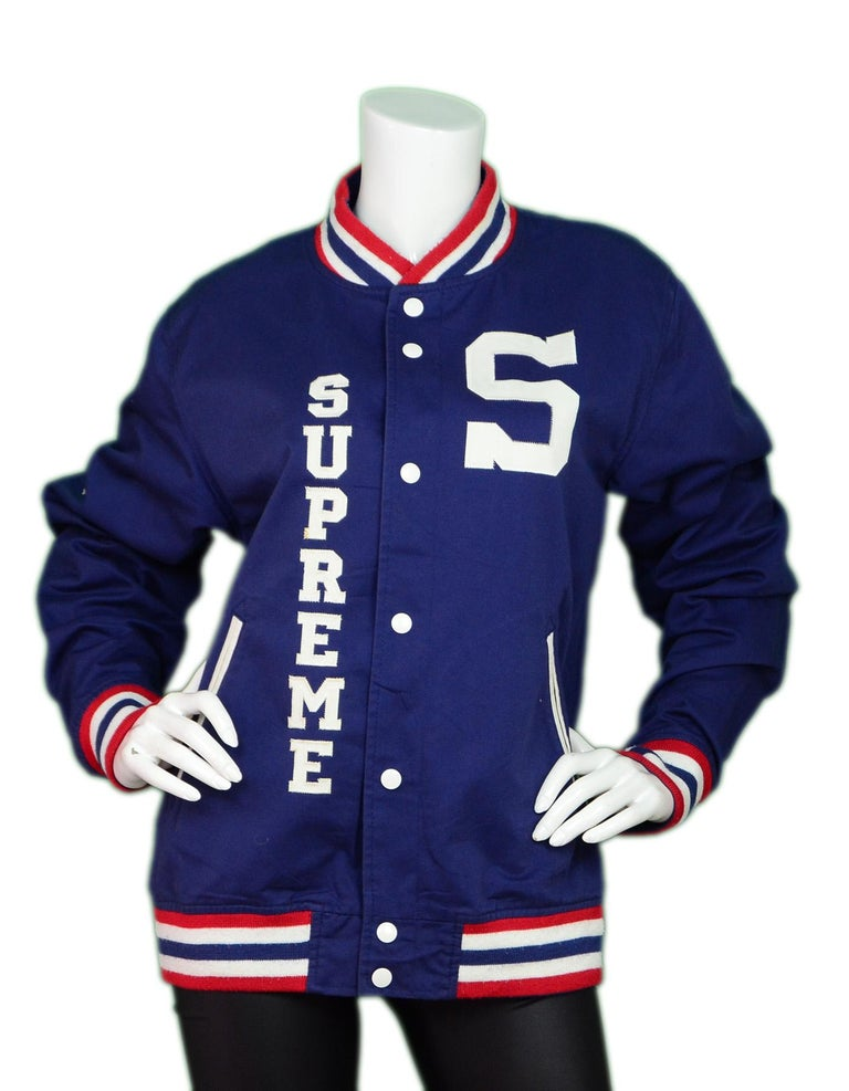 Supreme Navy Cotton Blend Logo Varsity Jacket Sz L Unisex  Made In: China Color: Navy blue, white, and red  Materials: 65% cotton, 35% polyester Opening/Closure: Button down front Overall Condition: Excellent condition with the exception of pilling