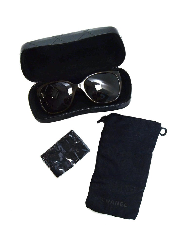 Chanel Brown Polarized Sunglasses W/ Tweed Arm & Boy CC Logo W/ Case & Dust Bag  Made In: Italy Color: Brown and grey/white tweed  Hardware: Silvertone Materials: Resin, metal, tweed Overall Condition: Excellent pre-owned condition Includes:  Chanel