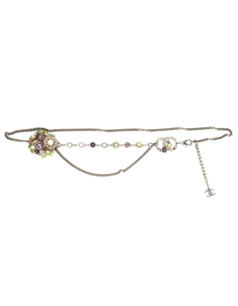 Chanel Silver Flower & CC Chain Link Belt Features faux pearls and rhinestone filled flower pendants and one hanging chain link tier  Made in: France Year of Production: 2005 Stamp: 05 CC P Closure: Lobster claw clasp Color: Silver, ivory, green