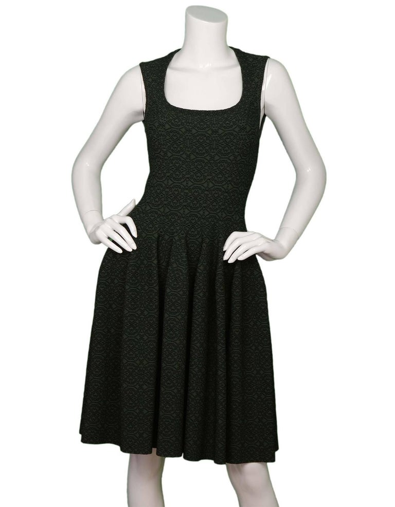 Alaia Dark Green Sleeveless Fit Flare Dress Features black dotted pattern throughout  Made in: Italy Color: Dark green and black Composition: 68% viscose, 21% nylon, 7% polyester, 4% elastane  Lining: None Closure/opening: Back center zip