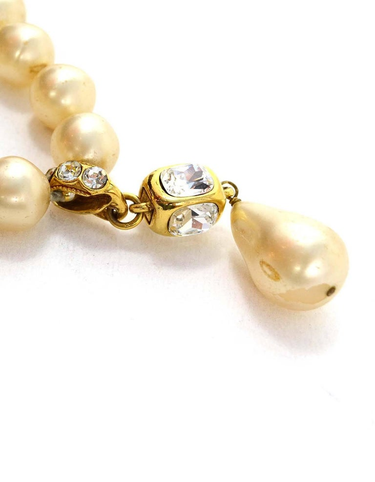 Chanel Vintage '86 Pearl & Crystal Tear Drop Necklace Features large goldtone, crystal and faux pearl tear drop pendant  Made In: France Year of Production: 1986 Color: Ivory and goldtone Materials: Faux pearls, metal and crystals Stamp: 2 CC